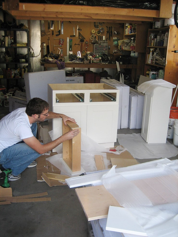 Kitchen renovation for less part 3 for Kitchen cabinets you put together