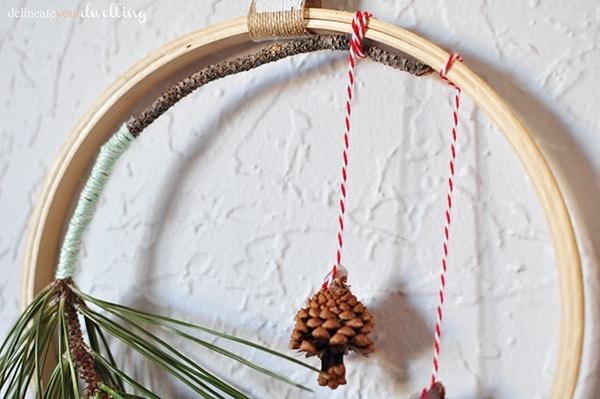 Evergreen Hanging Hoop pinecones, Delineateyourdwelling.com