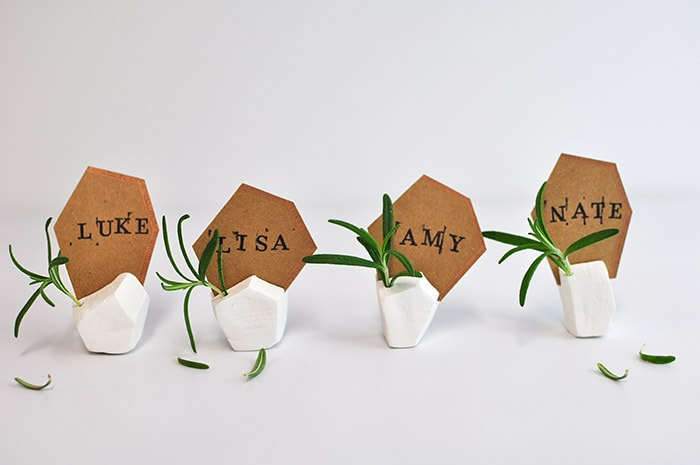 i paired my place card holders with emerald green goblets a few orange and white pumpkins and rose gold silverware